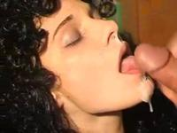 Dark and curly haired chick enjoying a cock