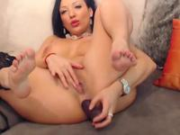 Milf with red lips dildoing her anal hole