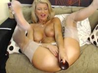 Big breasted blonde babe and her sex toys