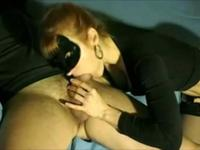 Masked girl sucks cock