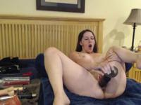 Chick is licking her sex toy