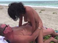 Two people fuck on the beach