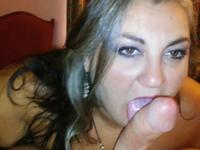 A mature lady licks a dick