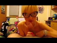 A hottie with glasses is cumshot