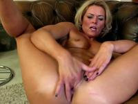 A blonde mature woman masturbates
