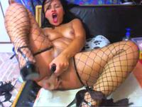 Black chick plays with her pussy