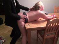 A blonde is fucked on the table