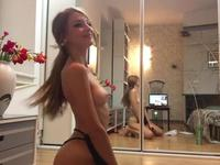 Slut dances in front of the mirror