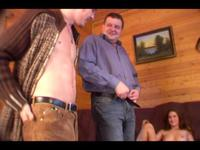 A prostitute is pleasing a handsome man in a country cottage
