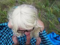 Blonde with glasses sucks cock and has sex near the lake