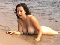 Big tits exposed on the nudist beach