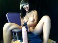 Asian webcam babe rides a dildo