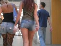 I am following two pretty girls wearing shorts and admiring their legs and also asses