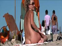 Hot nudist blonde enjoys a day at the beach