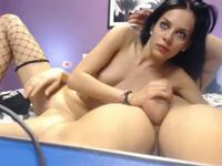 Stunning brunette teases with a webcam blowjob