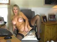 Busty milf sports stockings and plays with her pussy