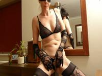 Milf in crazy outfit plays with her clit