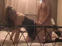 Blonde wears boots and gets drilled on bed
